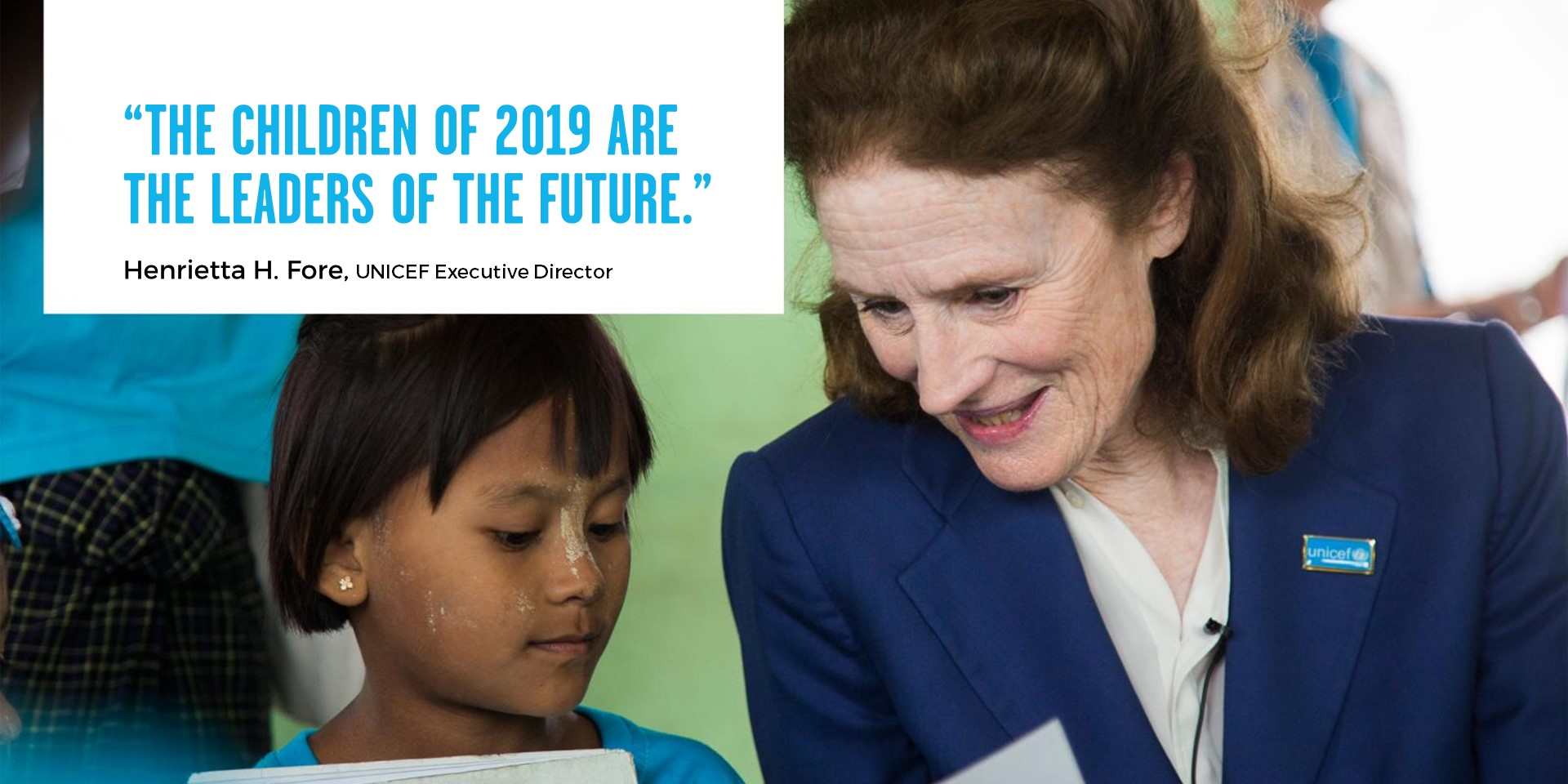 """UNICEF Executive Director Henrietta Fore with a child. In the photo a box with the caption """"The children of 2019 are the leaders of the future""""."""