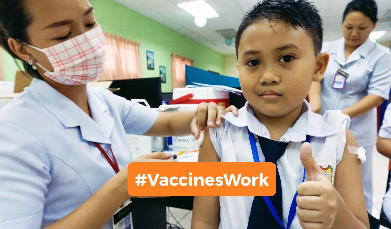 Boy receives a vaksin from a nurse.