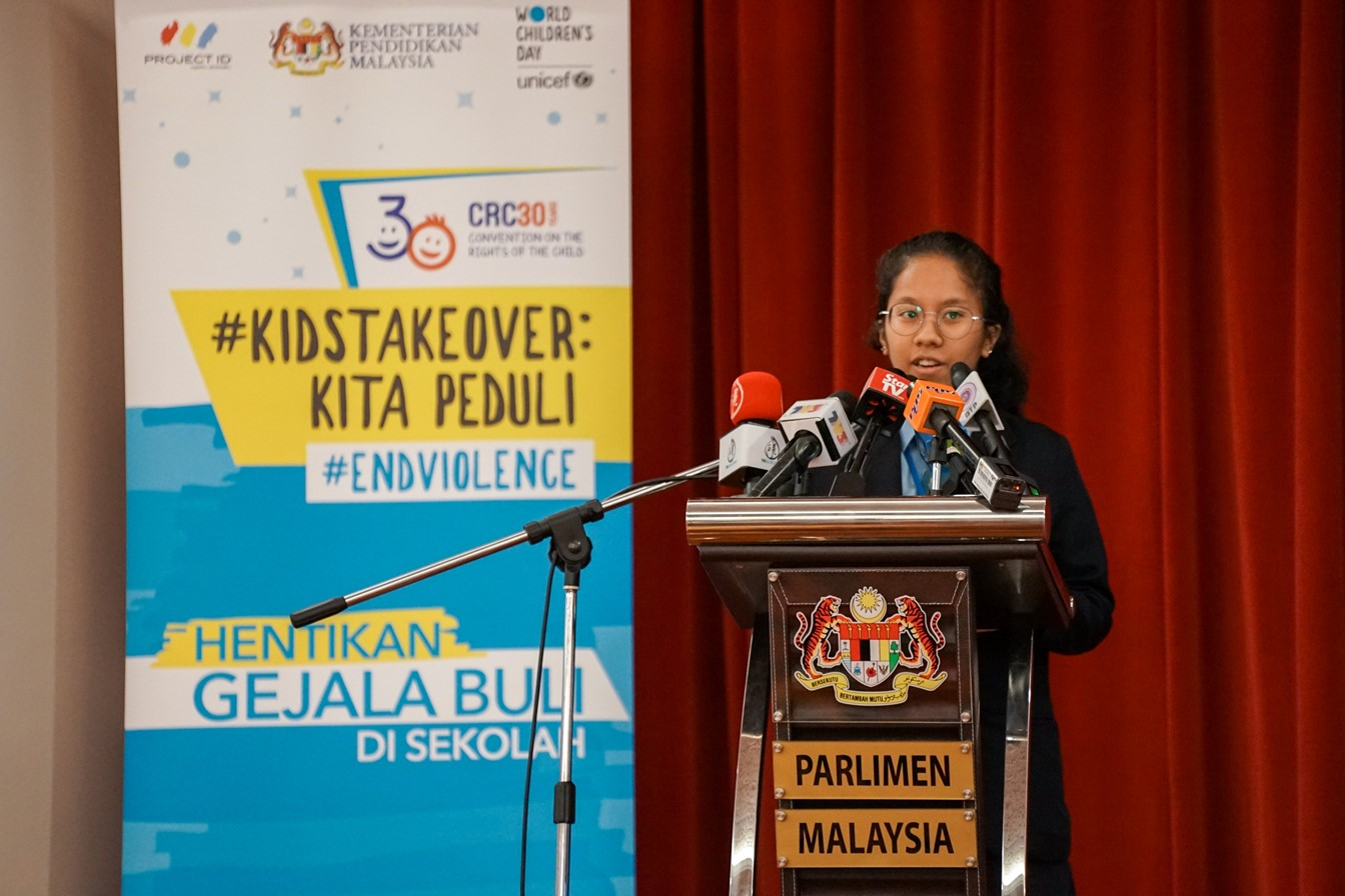 Myra Alyssa Faizal (16) from Kuala Lumpur presents the first set of recommendations for an Anti-Bullying School Policy during the KidsTakeover Parlimen.